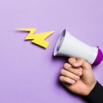woman-s-hand-showing-power-thunder-with-megaphone